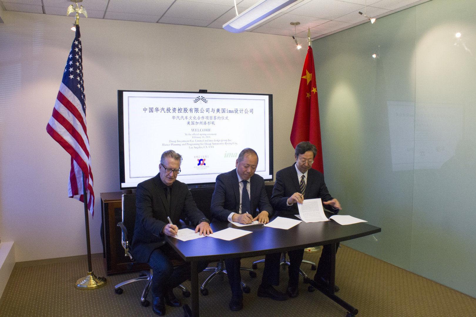 15-2-16 Huaqi Signing_3